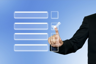 A man's hand and arm against a blue background, selecting a checkbox in a row of blank checkboxes.